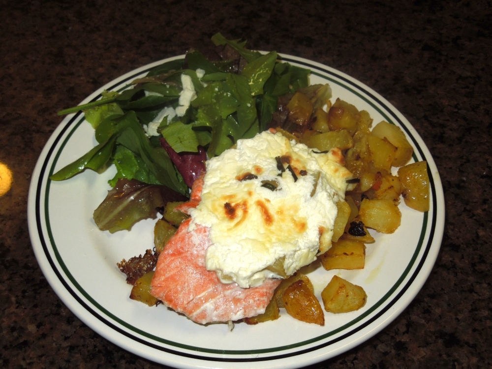 Salmon baked with cream cheese, chives, and potatoes with a side of lemony spring greens.
